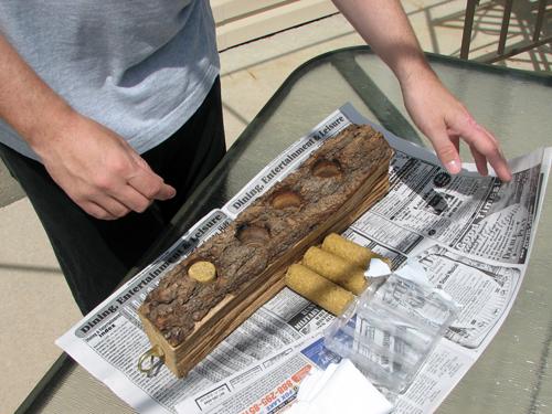 Filling a homemade suet log feeder